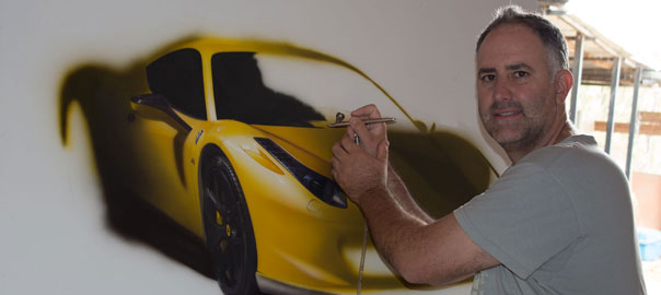 Artist-Ronen-Zlotogoura-working-on-hyperrealistic-painting-of-Ferrari
